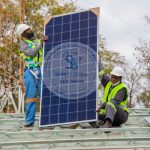 Shinko Workers installing a Solar Panel in Harare